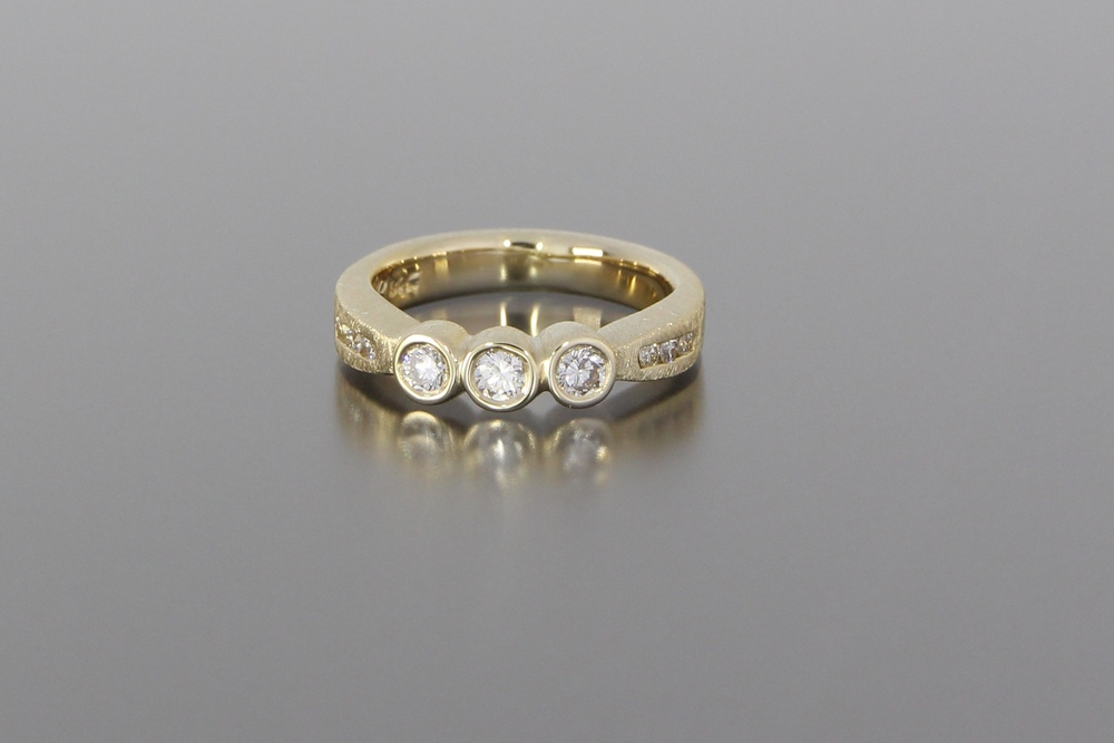 unique-hand-made-yellow-gold-three-stone-engagement-ring-craft-revival-jewelry-store-grand-rapids