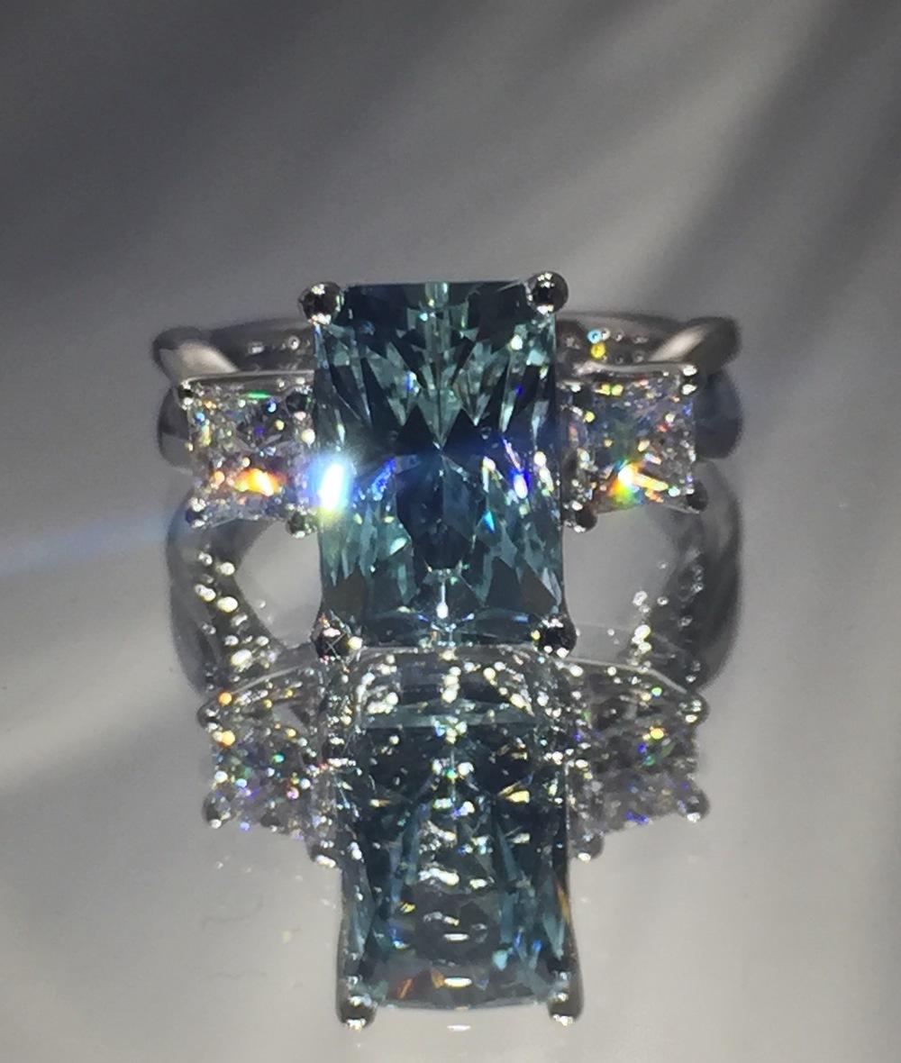 unique-aquamarine-emerald-cut-stone-princess-cut-diamonds-alternative-engagement-ring-craft-revival-jewelry-store-grand-rapids
