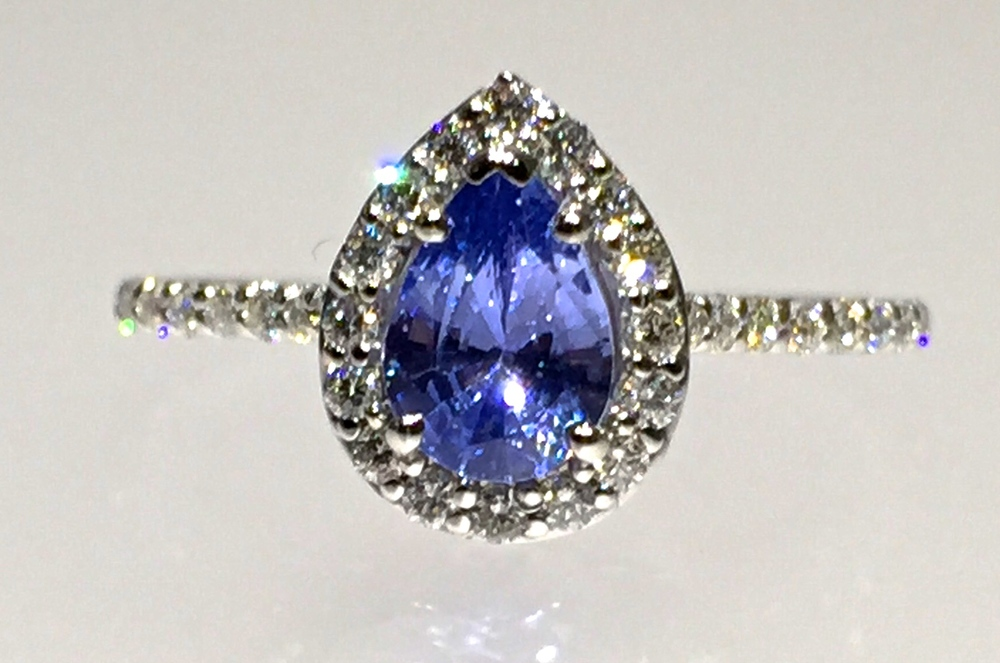 unique-tanzanite-pear-shape-delicate-halo-alternative-engagement-ring-craft-revival-jewelry-store-grand-rapids