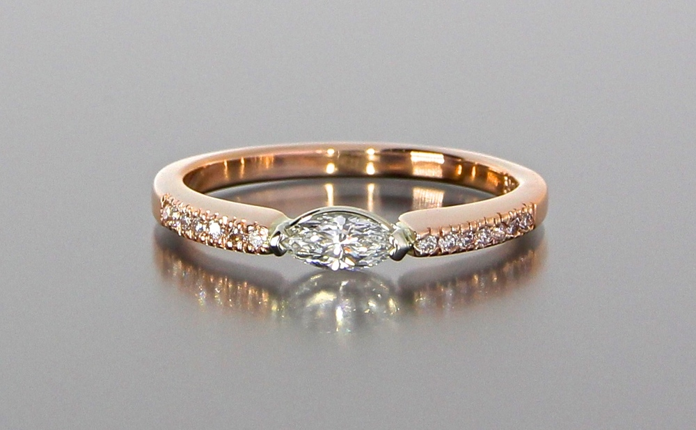 unique-dainty-marquise-cut-diamond-engagement-ring-craft-revival-jewelry-store-grand-rapids