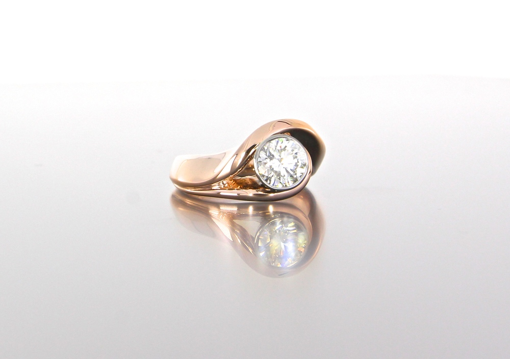 side-view-unique-rose-gold-round-diamond-modern-engagement-ring