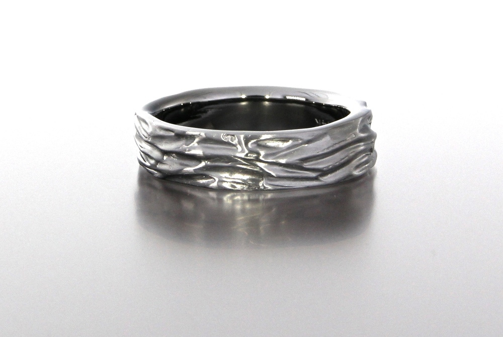 unique-mens-textured-wedding-band-black-band-gun-metal-gold-modern-design-craft-revival-jewelry-store-grand-rapids