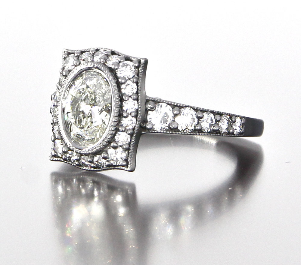 side-view-unique-oval-shape-diamond-halo-engagement-ring-craft-revival-jewelry-store-grand-rapids