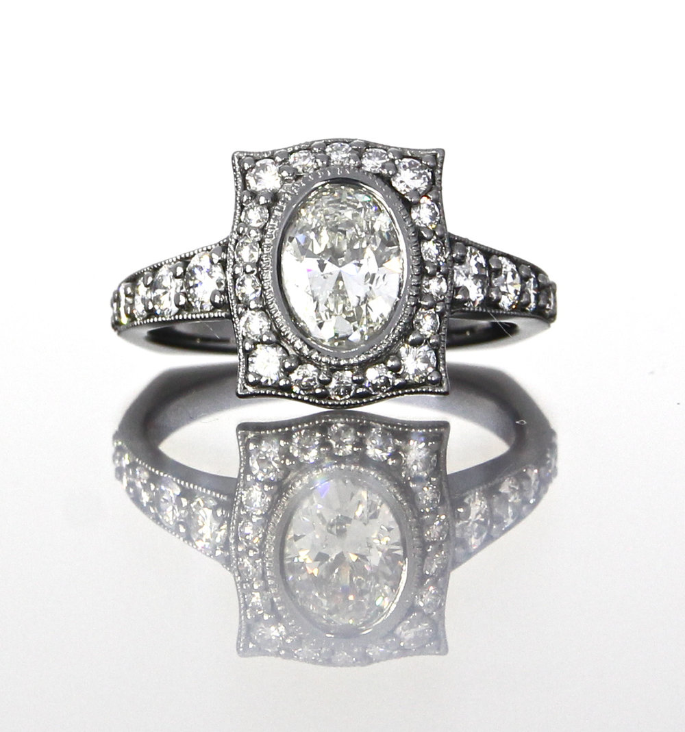 unique-oval-shape-diamond-halo-engagement-ring-craft-revival-jewelry-store-grand-rapids