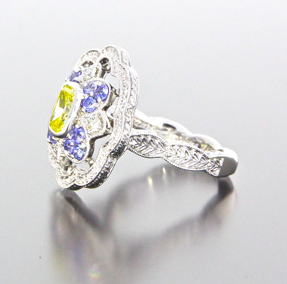 side-view-unique-antique-cushion-cut-yellow-diamond-halo-engagement-ring-craft-revival-jewelry-store-grand-rapids