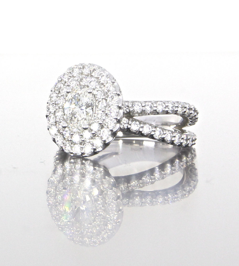 side-view-unique-delicate-oval-shape-diamond-double-halo-engagement-ring-craft-revival-jewelry-store-grand-rapids