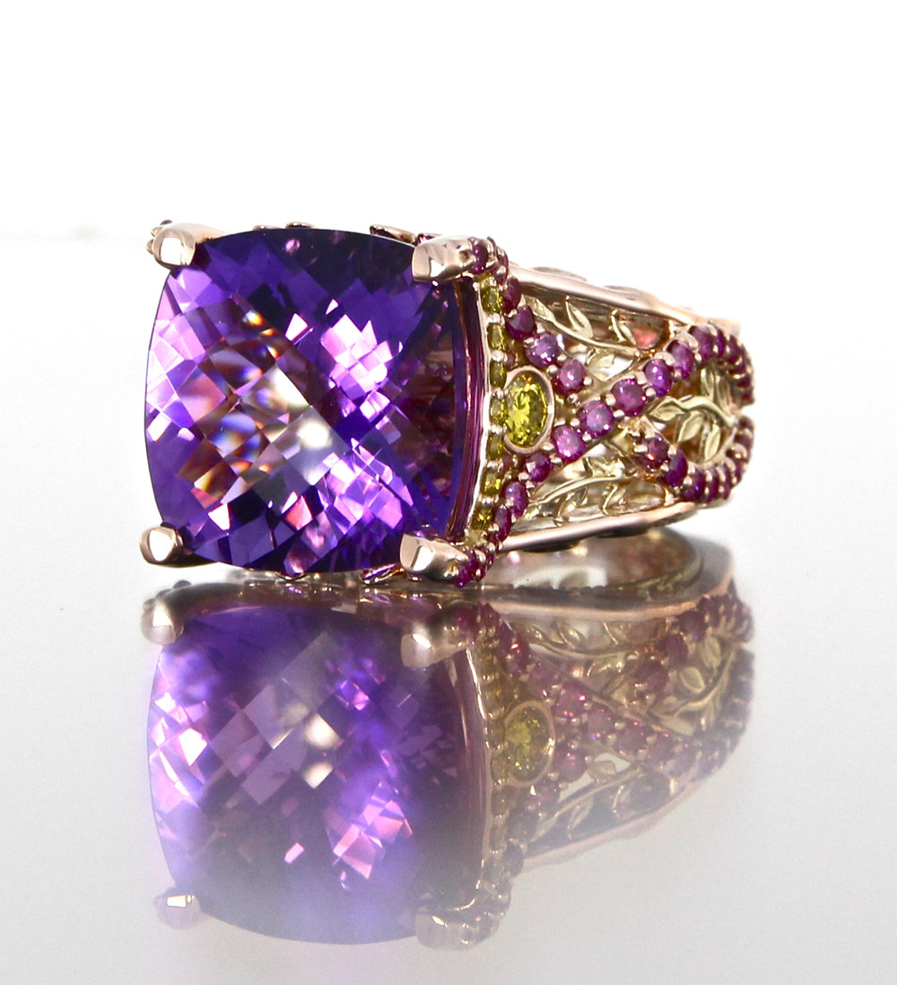 side-view-unique-cushion-shape-amethyst-engagement-ring-modern-design-pink-diamonds-yellow-diamonds-craft-revival-jewelry-store-grand-rapids