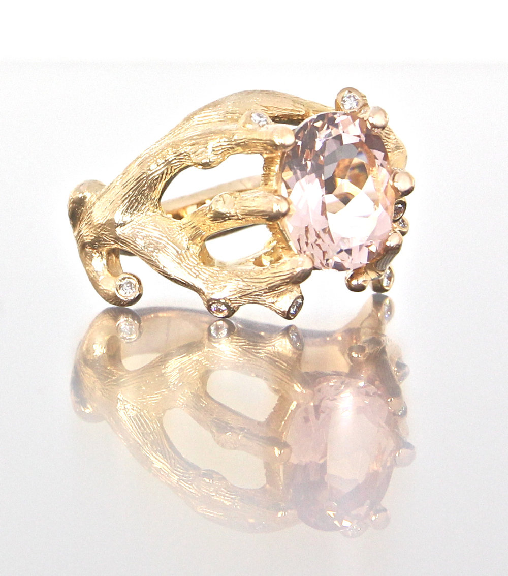 side-view-unique-oval-cut-morganite-diamond-alternative-engagement-ring-craft-revival-jewelry-store-grand-rapids