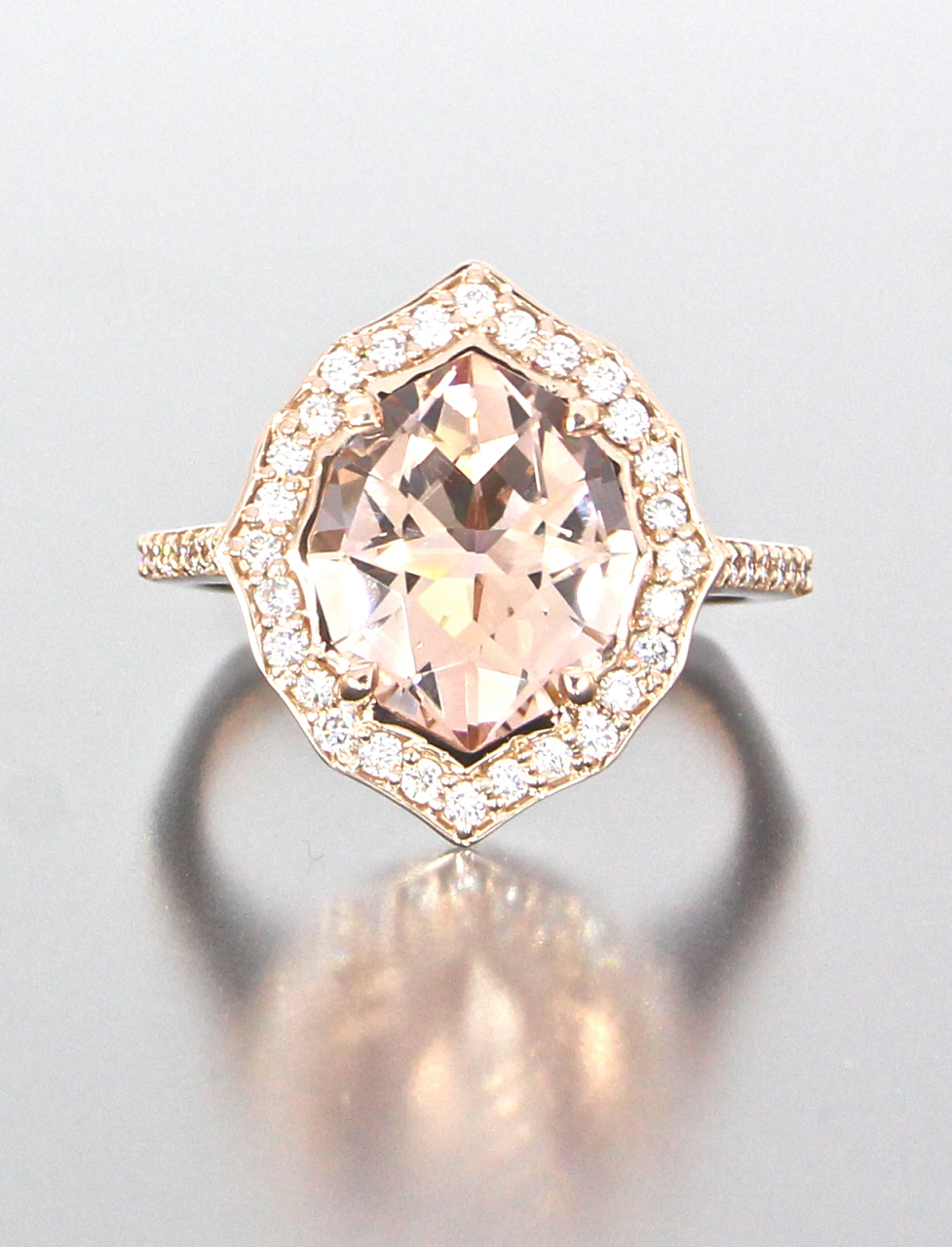 unique-rose-gold-halo-morganite-diamond-halo-engagement-ring-craft-revival-jewelry-store-grand-rapids