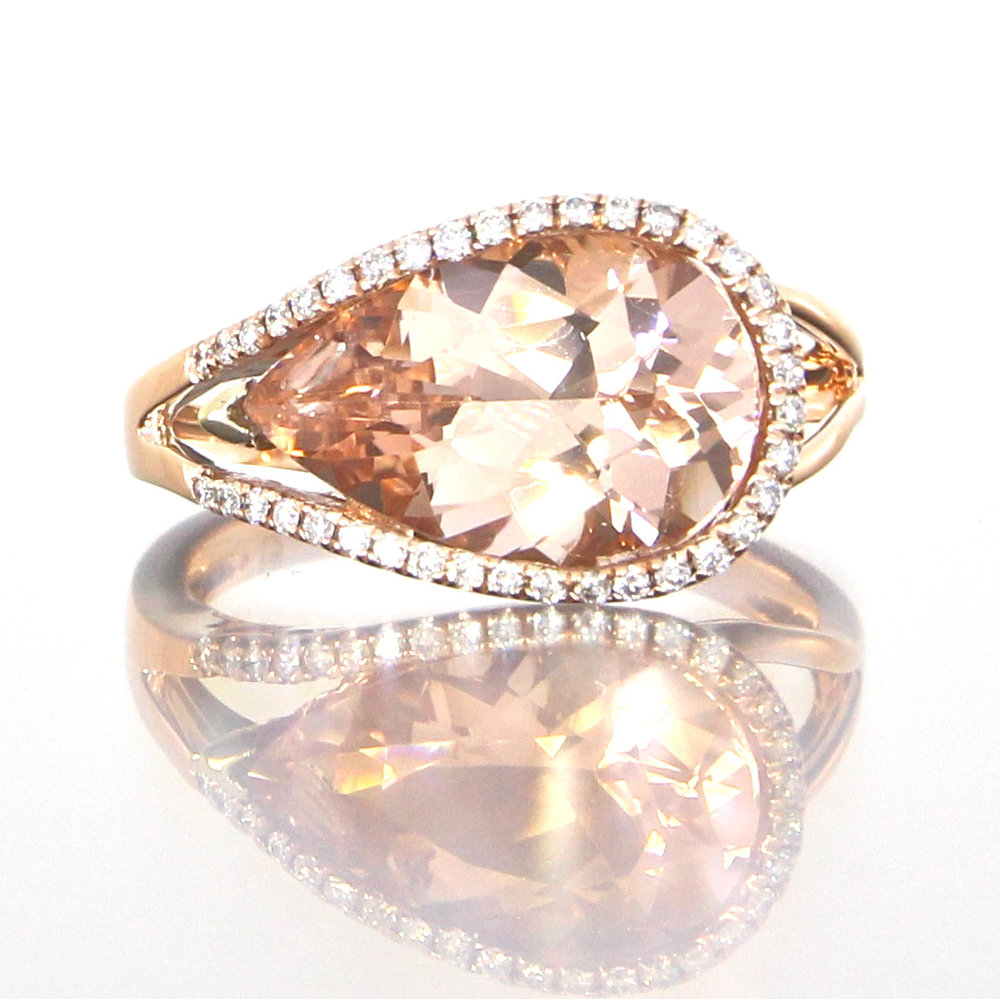 unique-halo-pear-shape-morganite-diamond-halo-engagement-ring-craft-revival-jewelry-store-grand-rapids