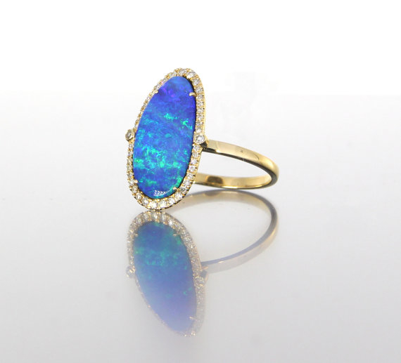 unique-oval-opal-delicate-diamond-halo-engagement-ring-craft-revival-jewelry-store-grand-rapids-side-view