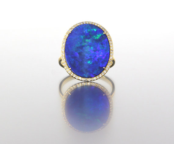 unique-oval-opal-delicate-diamond-halo-alternative-engagement-ring-craft-revival-jewelry-store-grand-rapids