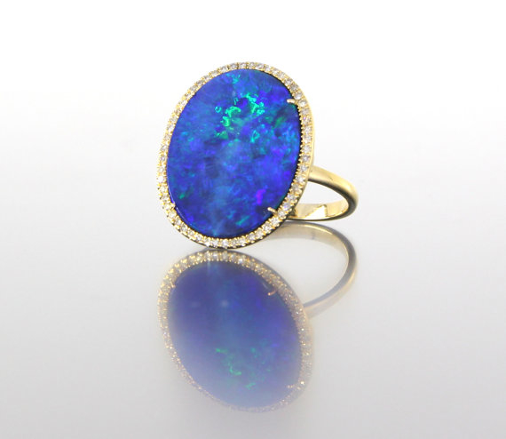 side-view-unique-oval-opal-delicate-diamond-halo-alternative-engagement-ring-craft-revival-jewelry-store-grand-rapids