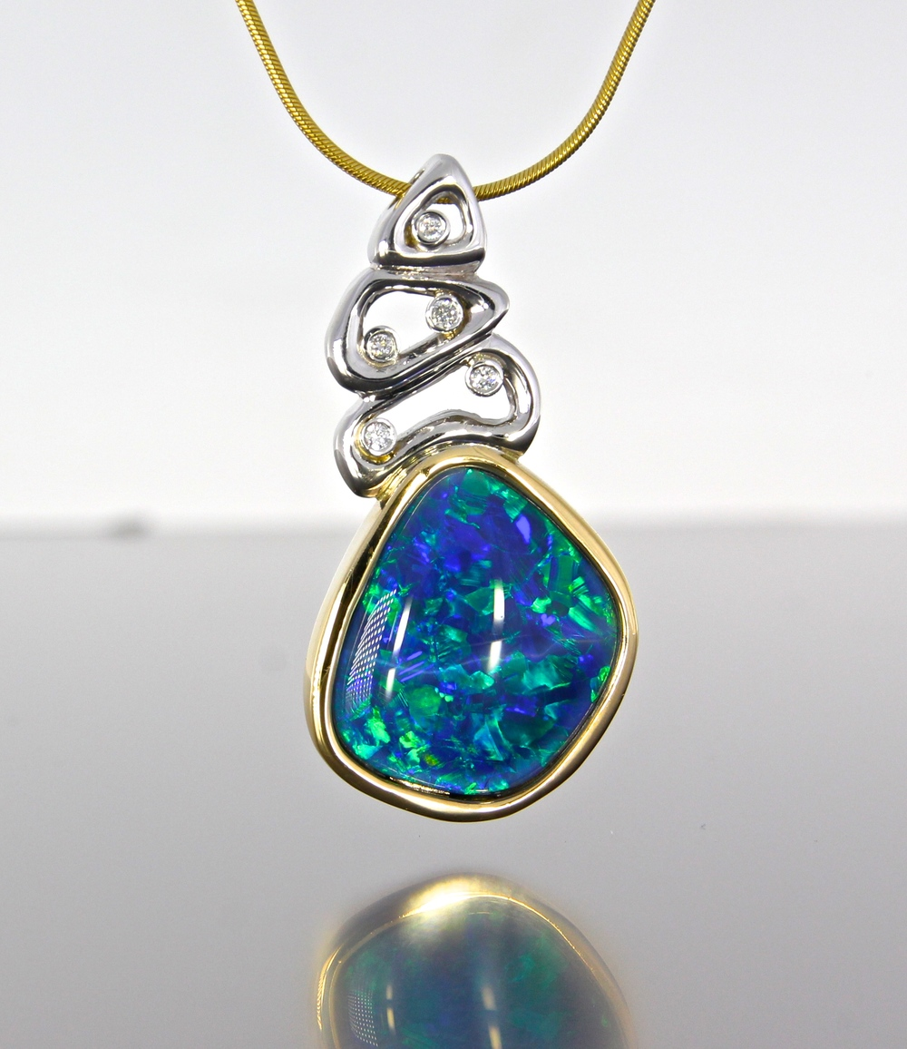 unique-opal-pendant-yellow-gold-white-gold-diamond-accents-fashion-pendant-craft-revival-jewelry-store