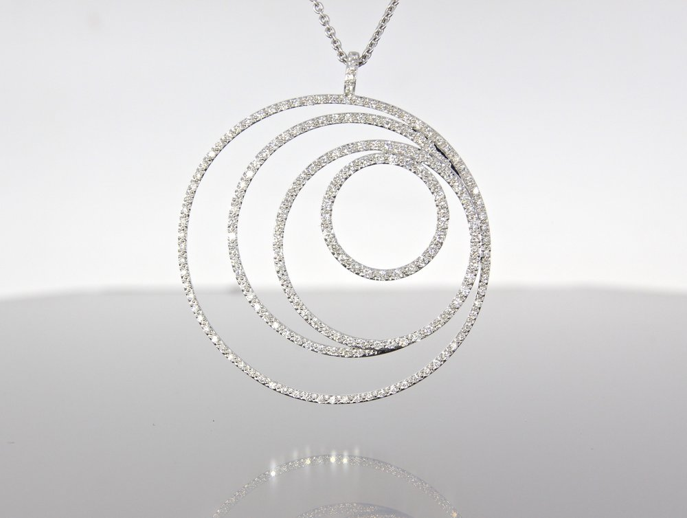 unique-open-circle-white-gold-diamond-pendant-craft-revival-jewelry-store-grand-rapids