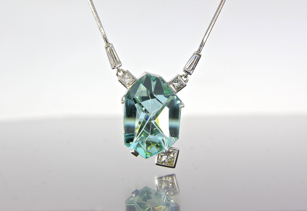 unique-custom-blue-tourmaline-munsteiner-stone-diamond-accents-white-gold-necklace-craft-revival-jewelry-store-grand-rapids
