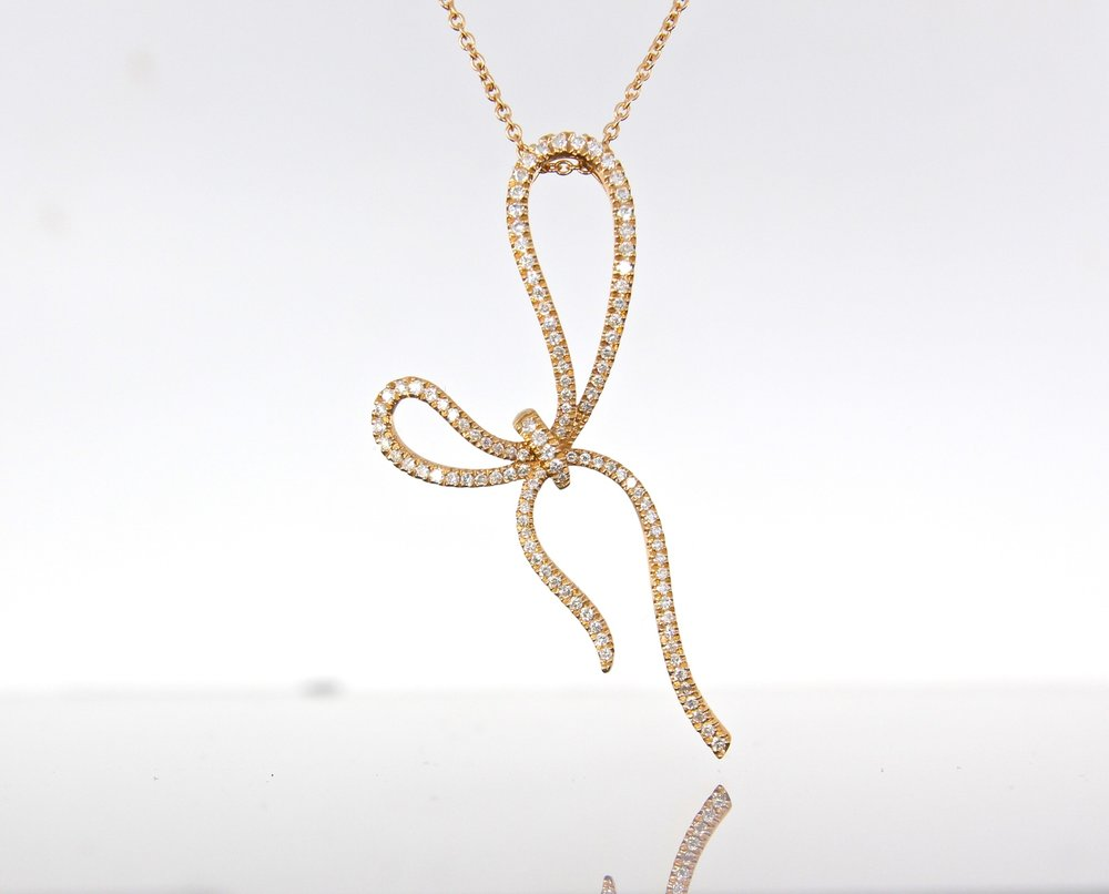 unique-delicate-diamond-bow-pendant-rose-gold-craft-revival-jewelry-store-grand-rapids