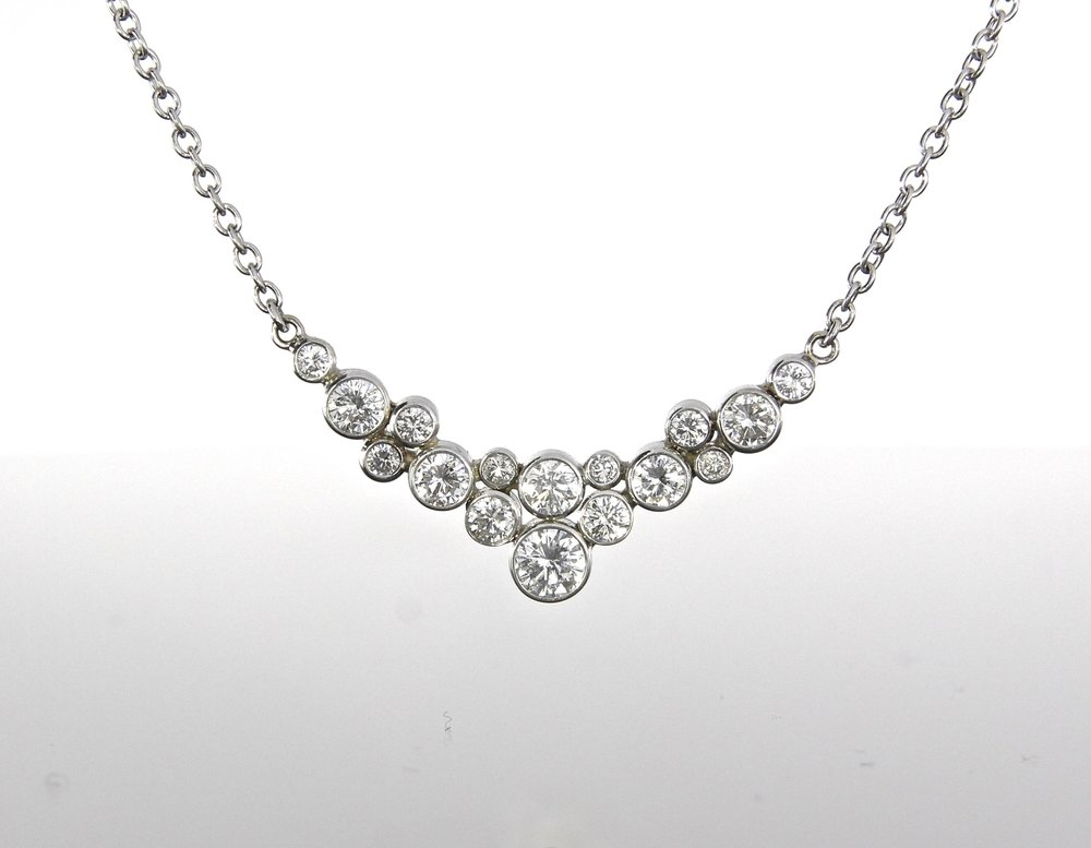 unique-diamond-bezel-set-cluster-necklace-white-gold-craft-revival-jewelry-store-grand-rapids