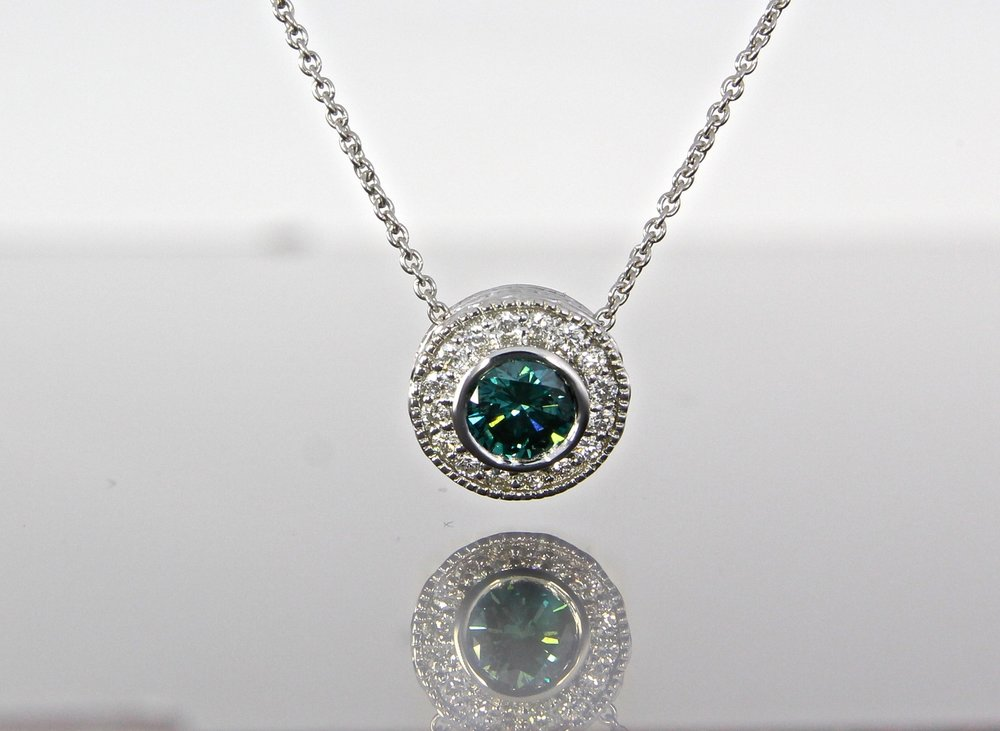 unique-teal-blue-diamond-white-gold-diamond-halo-slide-pendant-craft-revival-jewelry-store-grand-rapids