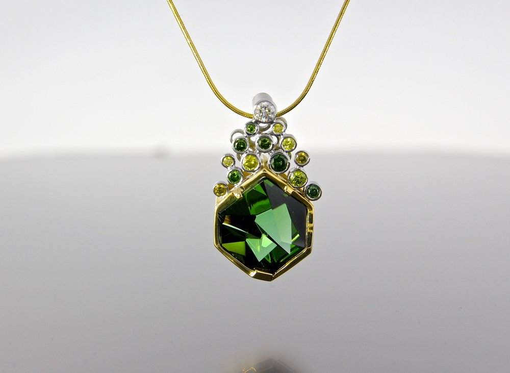 unique-green-tourmaline-munsteiner-stone-green-diamond-white-diamond-accents-yellow-gold-pendant-craft-revival-jewelry-store-grand-rapids
