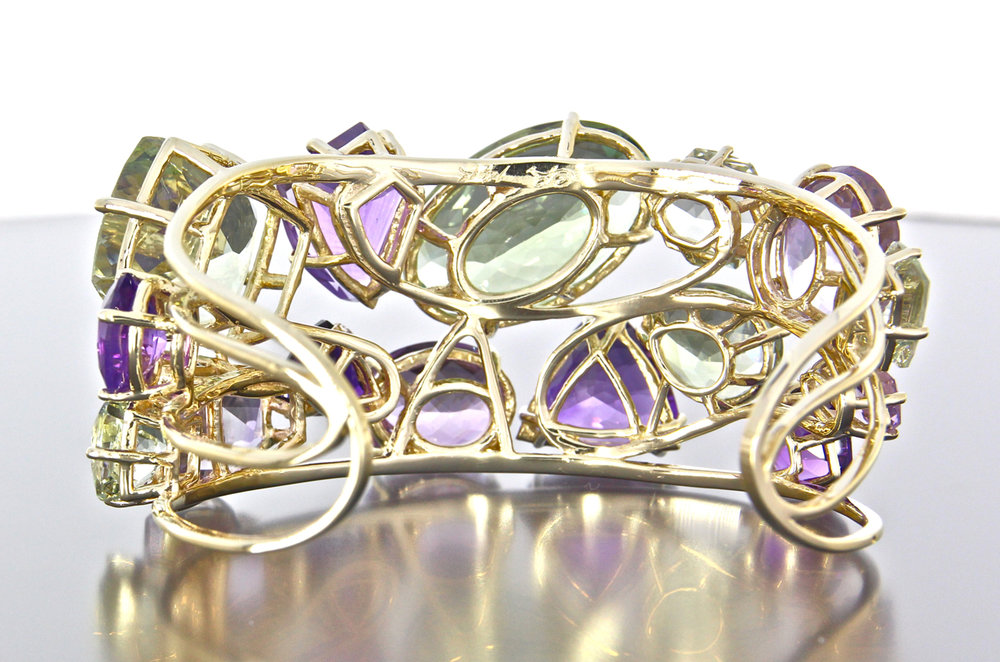 Beautiful filigree work on all custom cut gemstones
