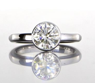 unique-delicate-round-diamond-engagement-ring-craft-revival-jewelry-grand-rapids
