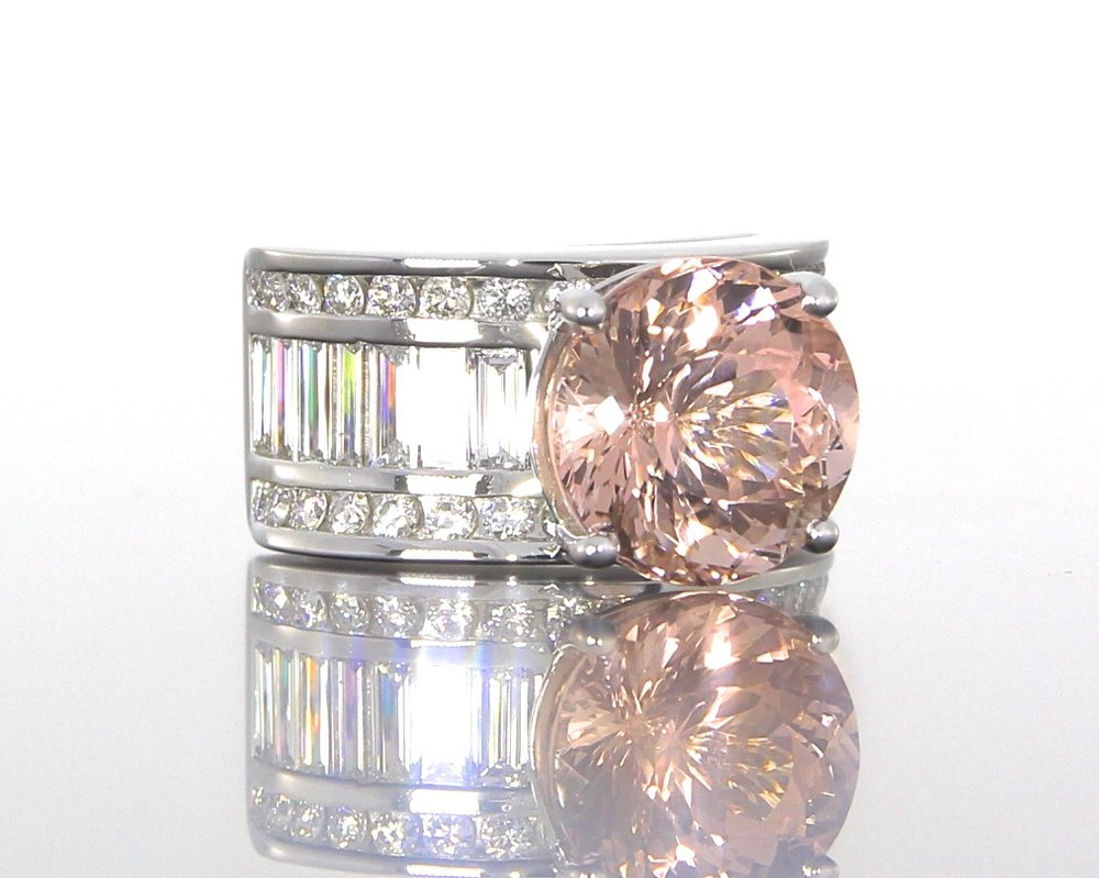 side-view-unique-morganite-platinum-baguette-diamond-engagement-ring-craft-revival-jewelry-store-grand-rapids.jpg