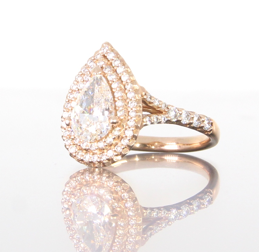 unique-pear-shape-diamond-halo-engagement-ring-craft-revival-jewelry-store-grand-rapids.jpg