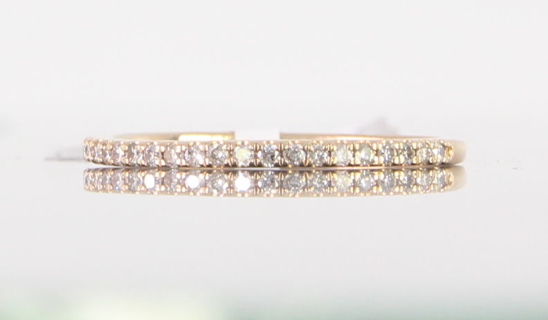unique-ladies-rose-gold-diamond-round-band-delicate-dainty-simple-wedding-band-craft-revival-jewelry-store-grand-rapids