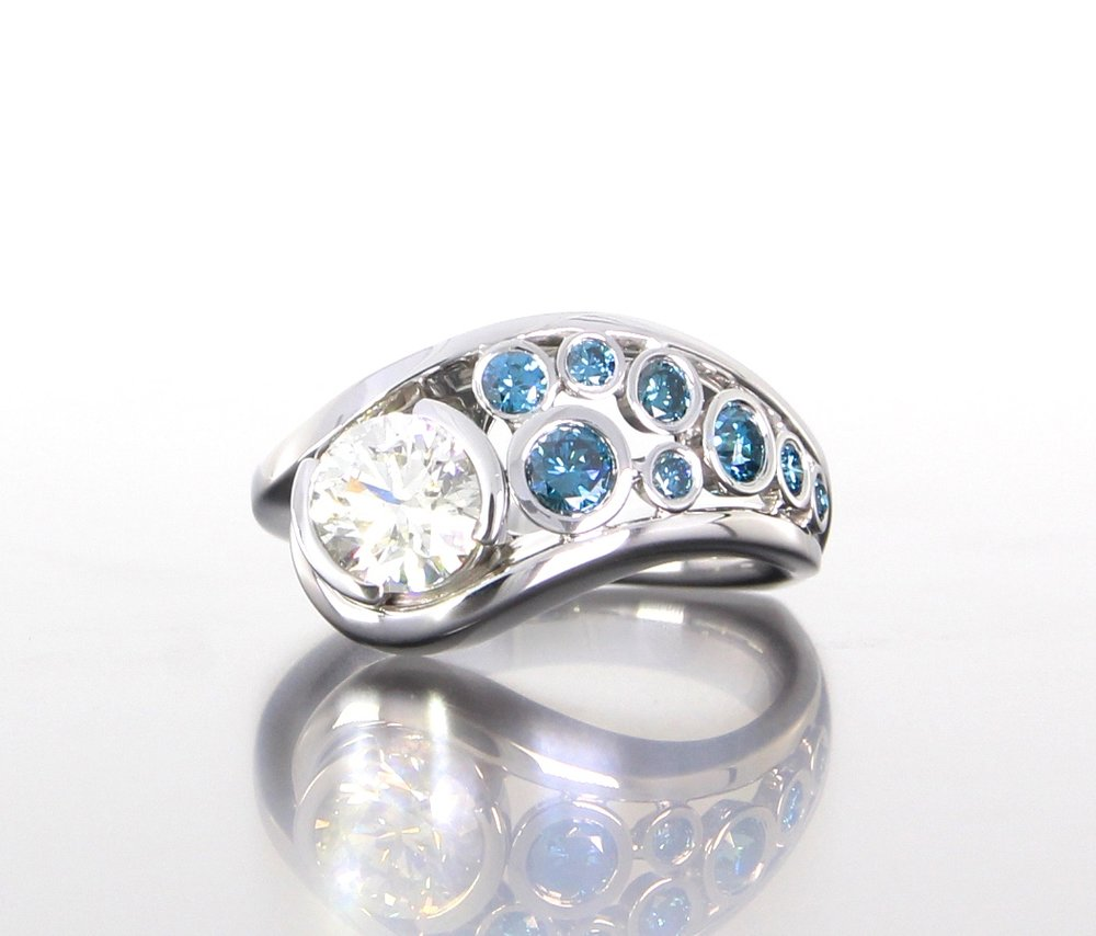 unique-diamond-engagement-ring-modern-design-blue-diamonds-craft-revival-jewelry-store-grand-rapids.jpg