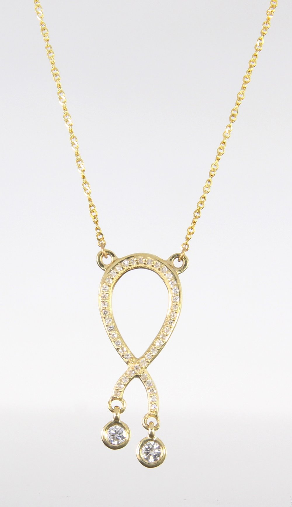 unique-diamond-fashion-pendant-ribbon-pendant-yellow-gold-delicate-necklace-grand-rapids-jewelry-store