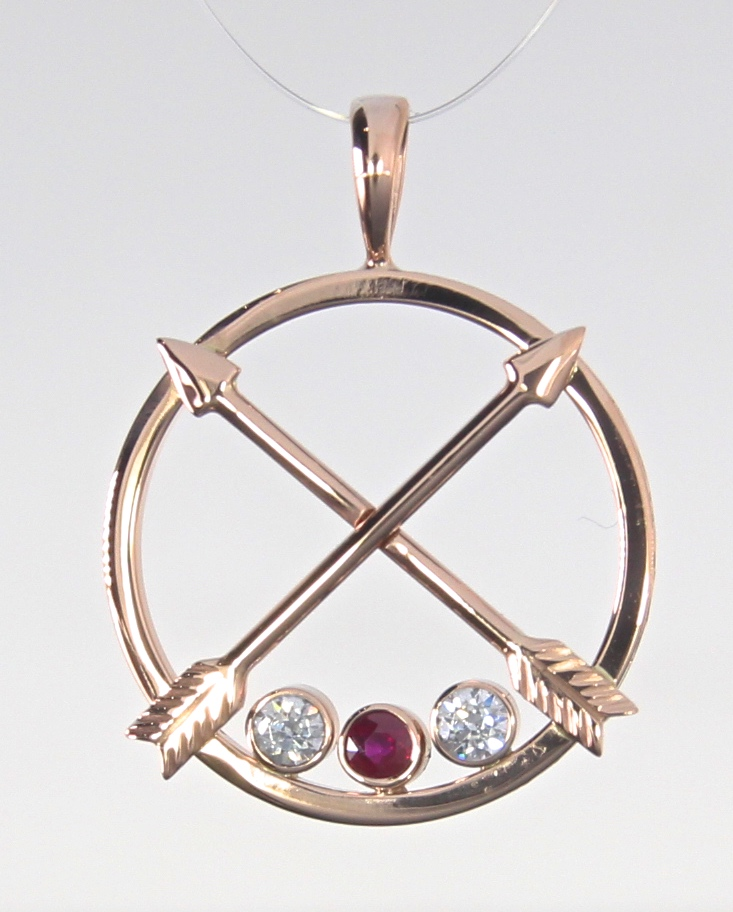 unique-rose-gold-arrow-pendant-diamond-ruby-accents-craft-revival-jewelry-store-grand-rapids
