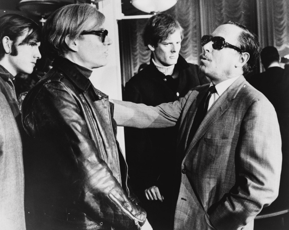 Man wearing a sweater 'Photo Bombs' Andy Warhol and Tennessee Williams
