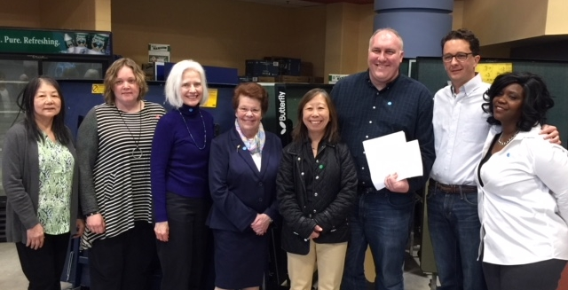 Newton Dems leaders (L-R) Betty Chan, Emily Prenner, Carol Fulton, Joan McGrath, Amy Sangiolo, Robert Fitzpatrick, Shawn Fitzgibbons and Sharon Stout.