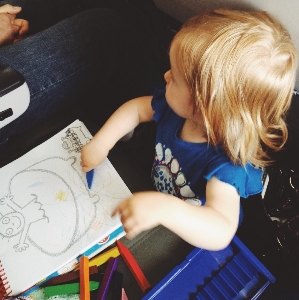 Lila drawing on the plane.