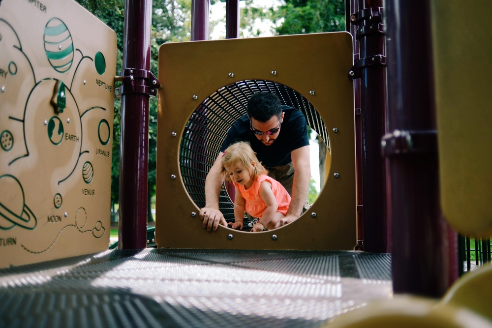 On the playground with Dad.