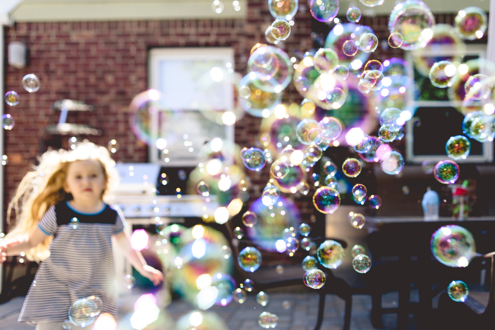 Little Girl Playing in Bubbles | Long Island Family Documentary Photographer