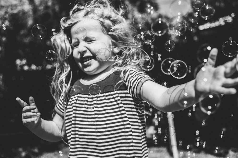 Girl plays in bubbles | Francesca Russell Photography & Films | Garden City Family Photographer