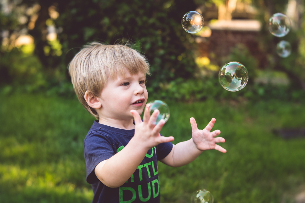 Boy playing with bubbles | Francesca Russell Photography | Nassau County Photographer