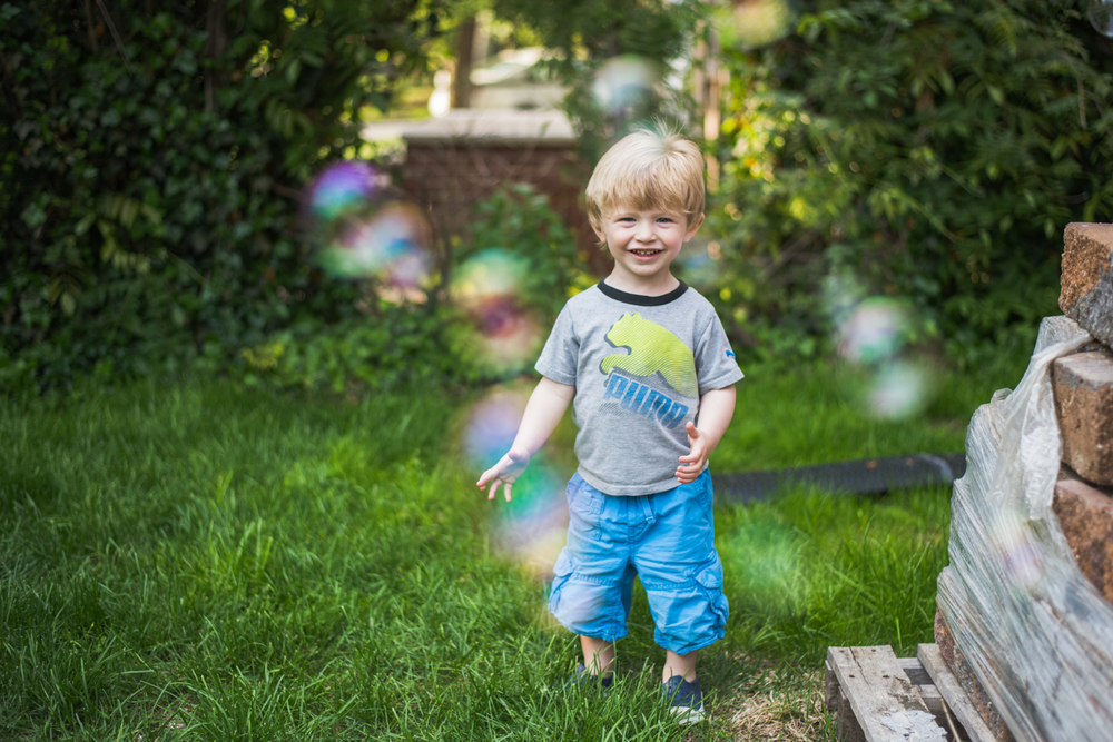Boy playing with bubbles | Francesca Russell Photography | Nassau County Family Photographer