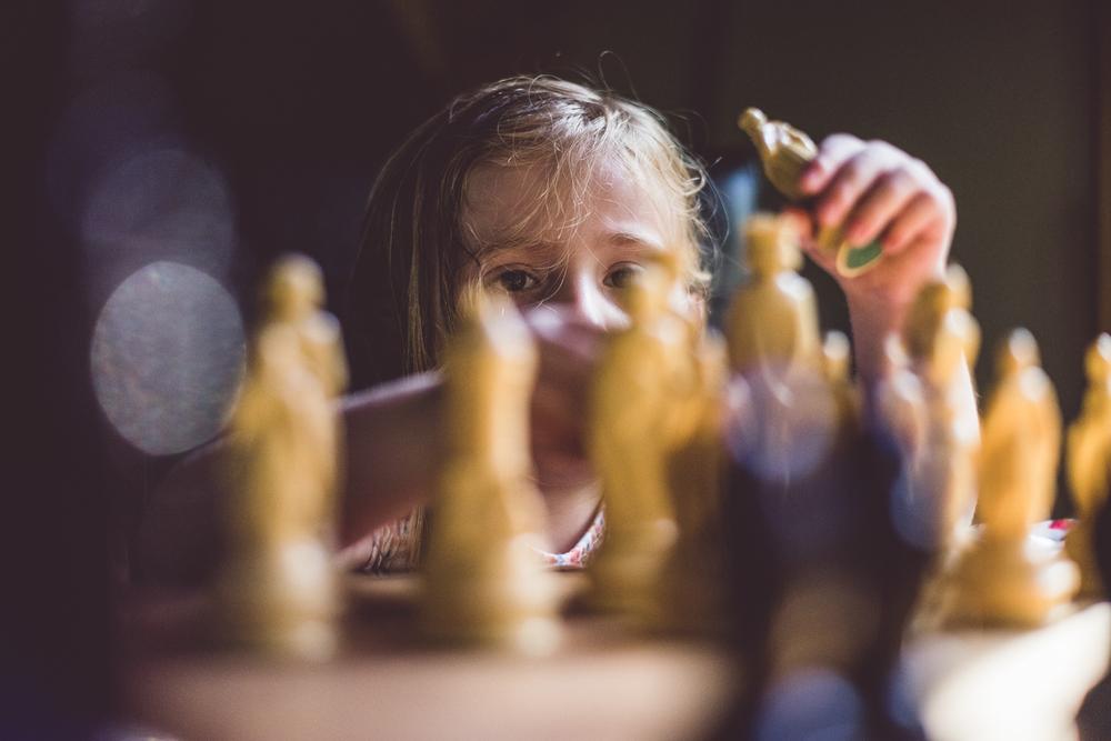 Lila playing chess.