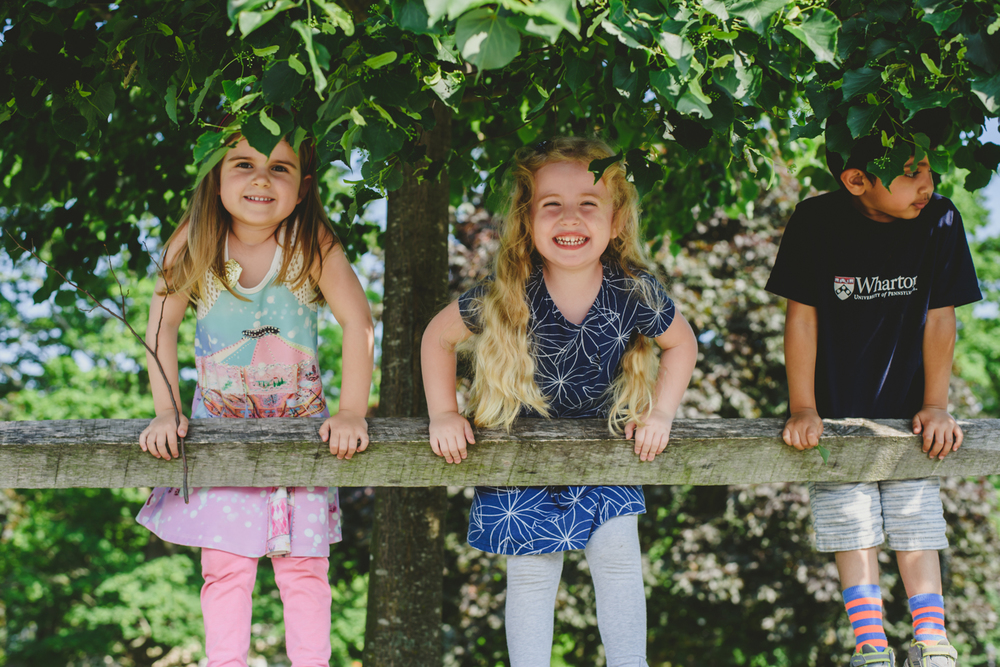 Francesca Russell Photography | Long Island Family Documentary Photography | Friends on a fence