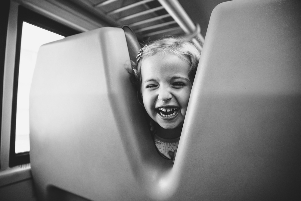 Francesca Russell Photography | Long Island Family Documentary Photography | Girl laughing on train