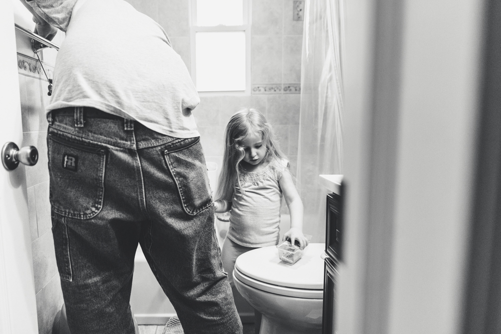Francesca Russell Photography | Long Island Family Documentary Photography | Man and daughter fixing towel bar