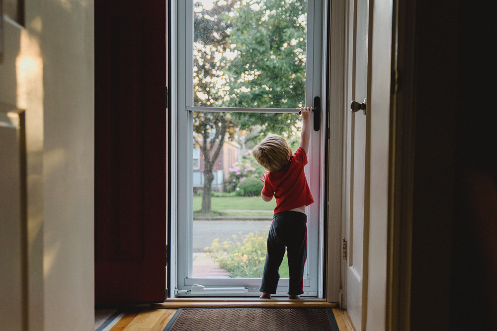 Francesca Russell Photography | Long Island Family Documentary Photography | Boy opening door