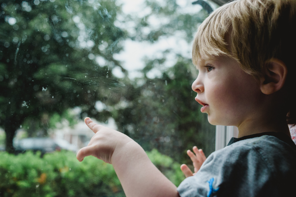 Francesca Russell Photography | Long Island Family Documentary Photography | Boy looking out window