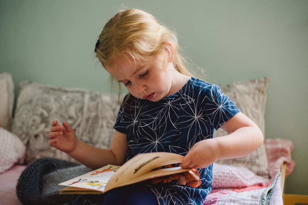 Francesca Russell Photography | Long Island Family Photographer | Girl looking at book