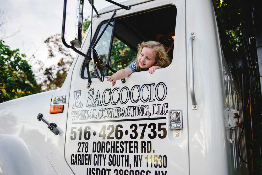 Francesca Russell Photography | Long Island Family Photographer | Little girl leans out truck window