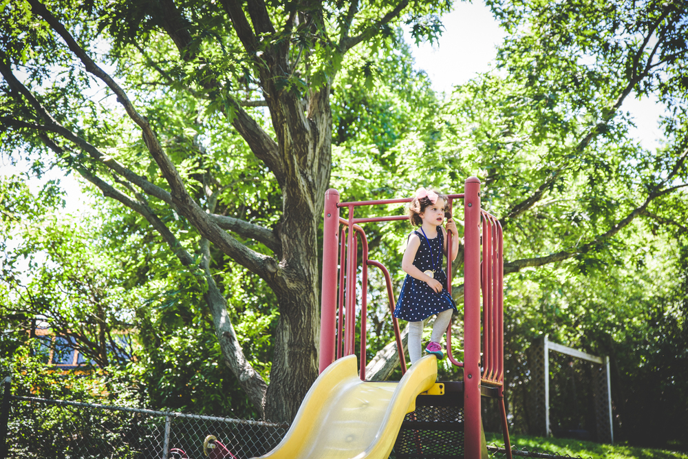 Francesca Russell Photography | Long Island Family Photographer | Girl on slide