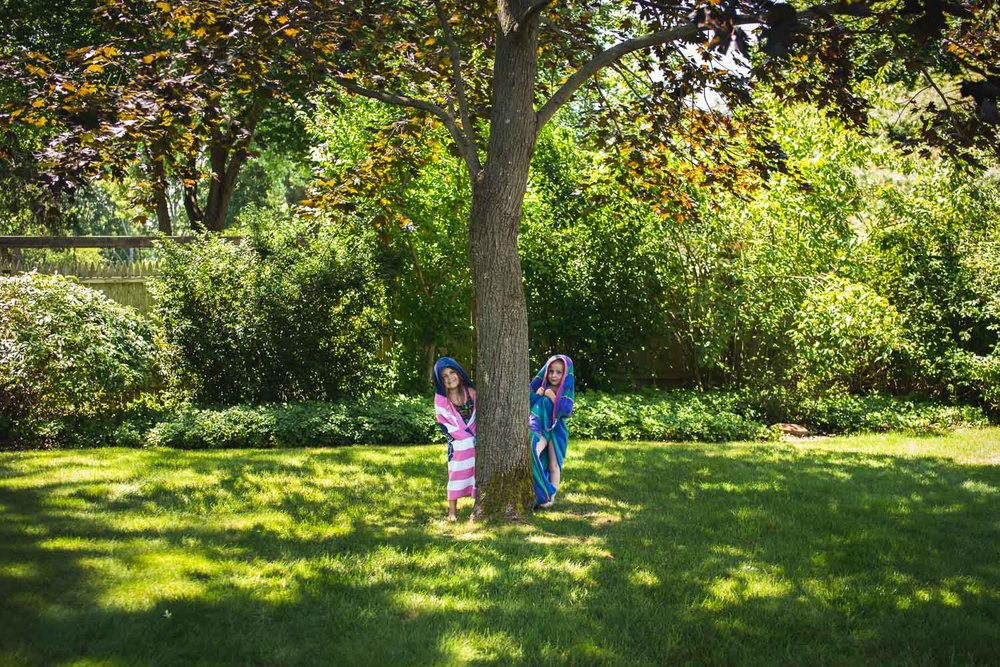 Francesca Russell Photography | Documentary Family Photographer on Long Island | Little Girls under a big tree